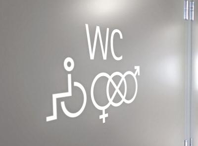 Unisex- ja pyörätuoli-symboli WC-tekstin kanssa Taiken wc:ssä