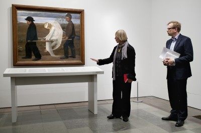 painting The Wounded Angel, a table with glass plates, Curator Nataša Jovičić and Acting Director of Museum Timo Huusko