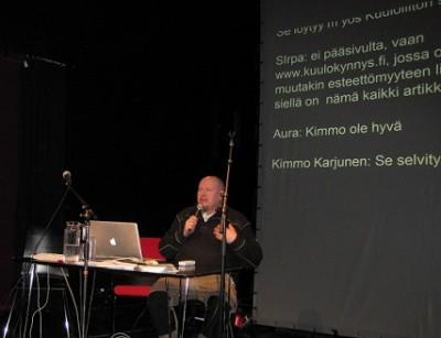 Kirjoitustulkkaus seinälle ja Kimmo Karjunen