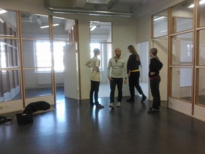 Staff looking around in the new office: many rooms with large windows