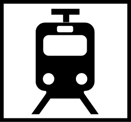 Valkoisella pohjalla musta raitiovaunu edestäpäin